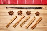 Cinnamon sticks, brown sugar, anise stars and vanilla beans — Stock Photo