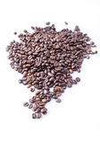 Roasted coffee beans pile from top on white background — Stock Photo