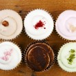 Stock Photo: Cupcakes on wooden background