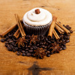 Chocolate cupcake on old wooden table — Stock Photo