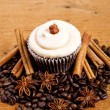 Chocolate cupcake on old wooden table — Stock Photo #41749311