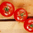 Tomatoes, cooked with herbs for preservation on old wood — Stock Photo #41749523