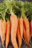 Fresh Organic Carrots on wooden background — Stock Photo