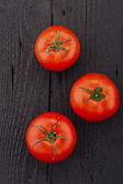 Tomatoes, cooked with herbs for the preservation on the old wood — Stock Photo