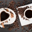 Two cups in heart shape of coffee with croissants and pieces of — Stock Photo
