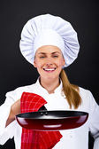 Young woman chef with tools on dark background — ストック写真