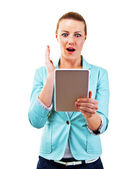 Smiling woman with tablet touching in shock — Stock Photo