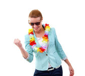 Woman with hawaii girlands and sunglasses smiling — Stock Photo