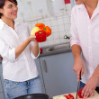 Happy young couple in the kitchen — Stock Photo #13627781
