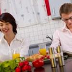 Portrait of a couple having breakfast — Stock Photo #13627792