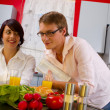 Happy young couple in their kitchen — Stock Photo