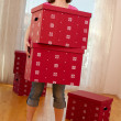 Attractive woman with big boxes in hands — Stock Photo #14075245