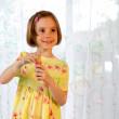 Little girl blows soap bubble — Stock Photo
