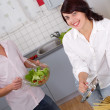 Happy young couple in the kitchen - Stock Photo