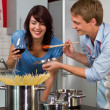 Happy young couple in the kitchen — Stock Photo #16287177