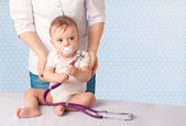 Doctor and baby patient. — Stock Photo