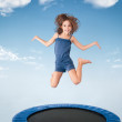 Cheerful young girl jumping — Stock Photo