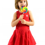 Little girl licking a lollipop — Stock Photo