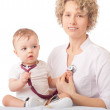 Pediatrician examining baby with stethoscope. — Stock Photo