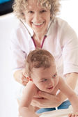 Pediatrician examining baby with stethoscope. — Stockfoto