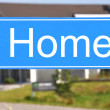 HOME sign against a house — Stock Photo
