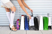 Girl with a bunch of shopping bags — Stock Photo