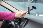 Driver entering an address into the navigation system — Stock Photo