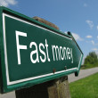 Fast money signpost along a rural road — Stock Photo