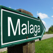 MALAGA signpost along a rural road - Stock Photo