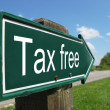 Tax free signpost along a rural road — Stock Photo