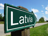 Latvia signpost along a rural road — Stock Photo