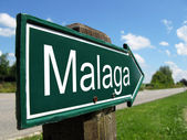 MALAGA signpost along a rural road — Stock Photo
