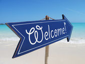 Welcome sign on the beach — Stock Photo