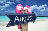 AUGUST sign on the beach — Zdjęcie stockowe