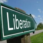 Liberation signpost along a rural road — Stock Photo