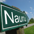 Nauru arrow signpost along a rural road — Stock Photo