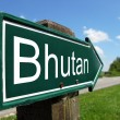 Bhutan arrow signpost along a rural road — Stock Photo