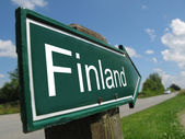Finland signpost along a rural road — Stock Photo