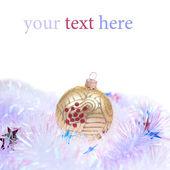 Christmas ball in tinse — Stock Photo