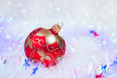 Red Christmas ball on star background — Стоковое фото