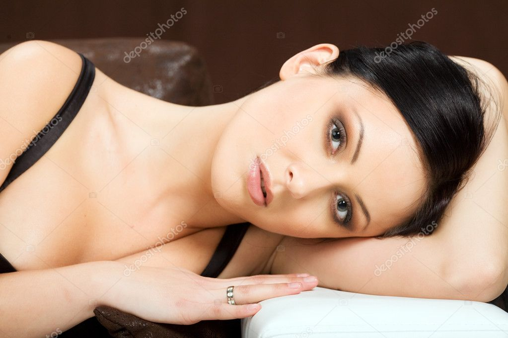 Portrait Of Sey Woman Laying On Couch Stock Image