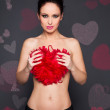 Sexy woman holding big heart — Stock Photo #18809233