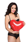 Sexy woman holding big heart — Stock Photo
