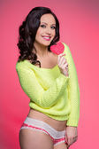 Sexy smiling woman with lollipop — Stock Photo