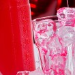 Stock Photo: Red drink with bottle of vodka