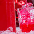 Red drink with bottle of vodka — Stock Photo