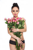 Woman with bouqet of roses — Stock Photo
