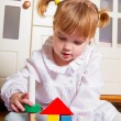 Child playing at home - Stock Photo