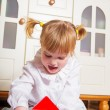 Stock Photo: Happy child playing at home