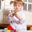 Child playing at home — Stock Photo #22206135
